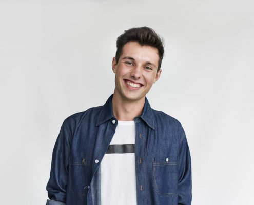 Young man smiling white teeth O2Dental Dentist Vancouver