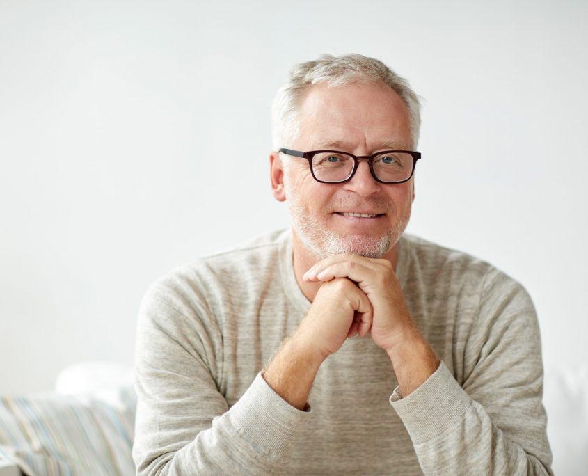 smiling senior man in glasses o2dental Vancouver Dentist